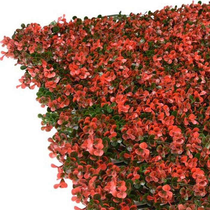jardín vertical hojas rojas